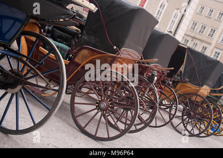 Horse drawn carriages in a row - Stock Photo