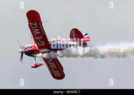 G-EWIZ, a Pitts S-2S Special 'Muscle Biplane' operated by Rich Goodwin Airshows, performing at the Scottish International Airshow over Ayr Bay in 2017 - Stock Photo