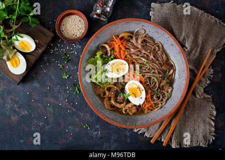 Japanese miso ramen noodles with eggs, carrot and mushrooms. Soup delicious food. Flat lay. Top view - Stock Photo
