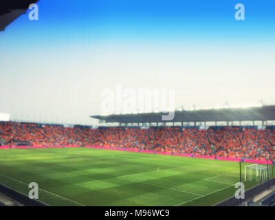 blurry of football stadium and stadium arena soccer field championship win for background - Stock Photo