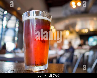 Close up shot of a glass of cold IPA beer, drink at Los Angeles - Stock Photo