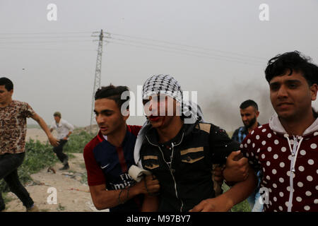 March 23, 2018 - Clashes occur between Palestinian protesters and Israeli soldiers in eastern Gaza, near the Gaza-Israeli border and the Israeli site of Nahal Oz. Palestinians were protesting for the 16th consecutive Friday rejecting the decision of US President Trump to recognize Jerusalem as the capital of Israel. Several clashes took place at different location in the Gaza Strip on Friday and during the clashes some protesters were injured by live ammunition and tear gas canisters fired at them by the Israeli Security forces. Similar clashes also erupted in many parts of the West Bank follo - Stock Photo