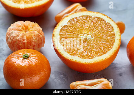 Variety of fresh citrus for making juice or smoothie over light textured background, topview, selective focus. Tropical summer mix with orange, tanger - Stock Photo