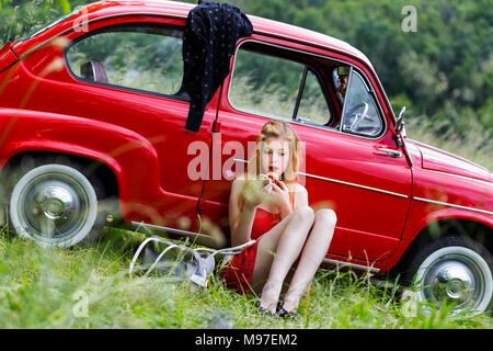 Teen girl heeled shoes high heels - Stock Photo