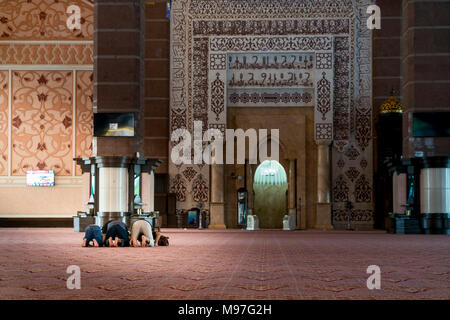 Group of Religious muslim man praying inside the mosque. Islamic praying, prostrating on the ground. - Stock Photo