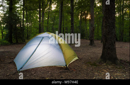 Tent set up on Uwharrie National Forest at sunset - Stock Photo