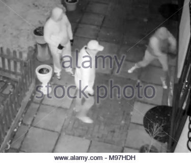 Handout video screengrab dated 05/03/18 issued by the Metropolitan Police of three of the four men who were wielding crowbars and hammers to force their way into a house in Chislehurst. Police are hunting for the gang as it is believed that they are behind a spate of burglaries in an affluent London suburb. - Stock Photo