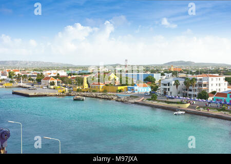 Kraledijk capital town of Bonaire, Dutch Antilles, Caribbean Sea, as seen from a cruise liner ship: as flat as a pancake - Stock Photo