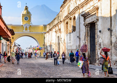 Antigua, Guatemala -  March 18, 2018: Popular tourist street with Santa Catalina arch & ruins in UNESCO World Heritage Site - Stock Photo