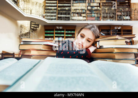 Girl with Books in the Library - Stock Photo