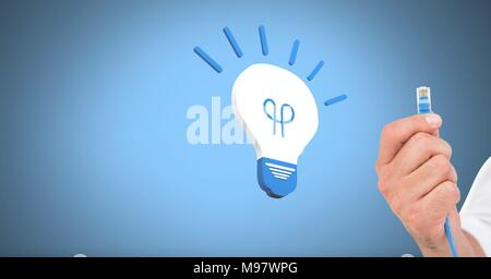 Hand holding wire connection with light bulb icon - Stock Photo
