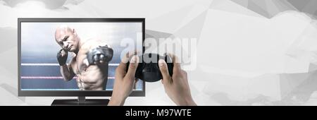 Hands holding gaming controller  with mixed martial arts fighter on television - Stock Photo