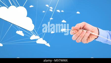 Hand holding wire connection with clouds - Stock Photo