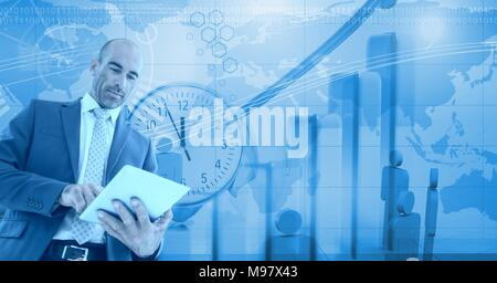 Businessman using tablet with Tall building bank with time and world people icons - Stock Photo