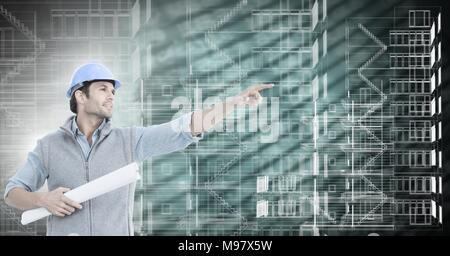 Architect pointing and building blue prints over green background - Stock Photo