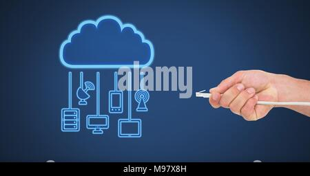 Hand holding wire connection with cloud devices - Stock Photo