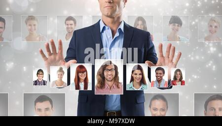 Man touching portrait profiles of different people - Stock Photo