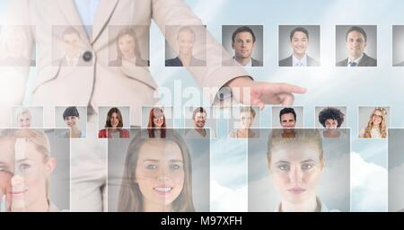 Hand touching portrait profiles of different people - Stock Photo