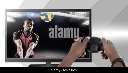 Hands holding gaming controller  with volleyball player on television - Stock Photo