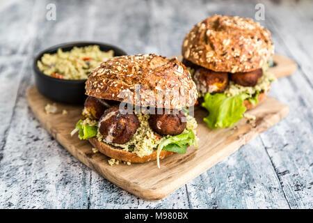 Falafel Burger with Tabbouleh - Stock Photo