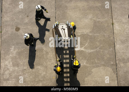fire-fighter working at hight, 13.5m Ladder - Stock Photo