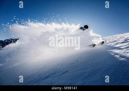 Austria, Tyrol, Mutters, skier on a freeride in powder snow - Stock Photo