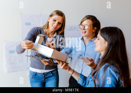 Team of architects working on a project - Stock Photo