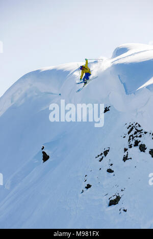 Austria, Tyrol, Alpbach, skier on a freeride jumping above snowdrift - Stock Photo