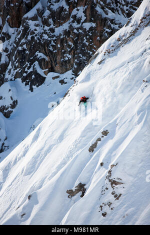 Austria, Tyrol, Arlberg, skier on a freeride in powder snow - Stock Photo