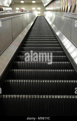 An empty escalator on the London Underground. - Stock Photo