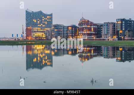Germany, Hamburg, Hafencity, modern buildings and Elbe Philharmonic Hall in the evening - Stock Photo