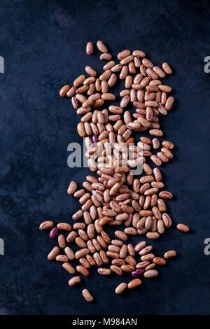 Pinto Beans on dark ground - Stock Photo