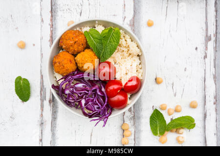 Buddha bowl of sweet potato balls, Couscous, Hummus and vegetables - Stock Photo