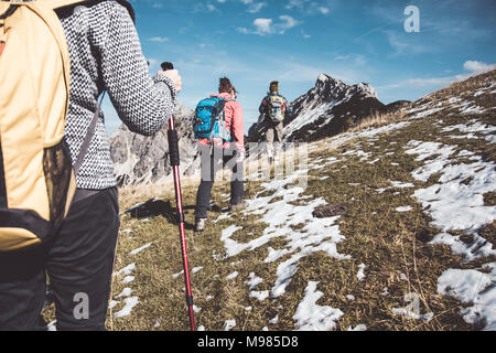 Austria, Tyrol, three hikers walking in the mountains - Stock Photo