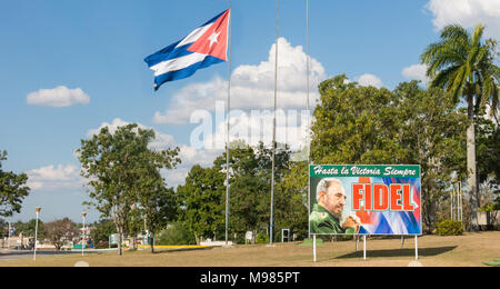SANTA CLARA, CUBA-JANUARY 6, 2017: Poster with image of Fidel Castro and Cuban flag in the Revolution square in the city of Santa Clara, Cuba. Next is - Stock Photo