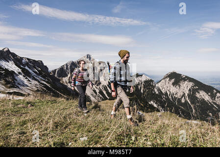 Austria, Tyrol, young couple hiking in the mountains - Stock Photo