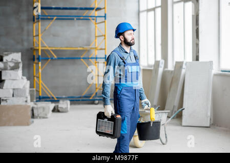 Builder at the construction site - Stock Photo