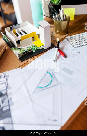 Blueprints and pens on an architect's desk - Stock Photo