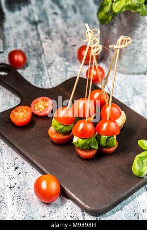 Tomato mozzarella sticks, basil
