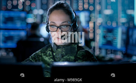 Female IT Engineer Works on Her Desktop Computer in Government Surveillance Agency. In the Background People at Their Workstations with Displays - Stock Photo