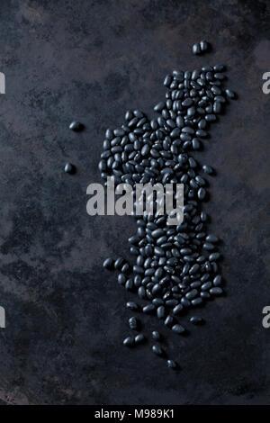 Black mungbeans on dark metal - Stock Photo