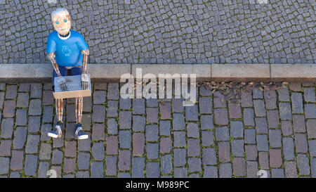 Robot sitting on curb using laptop, 3d rendering - Stock Photo