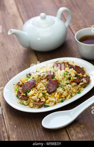 chinese sausage fried rice, xiang chang chao fan with oolong tea - Stock Photo