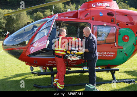 Pilot and doctor outside an Airbus helicopter of the Wales Air Ambulance service - Stock Photo