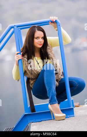 Teen girl heeled shoes high heels squatting - Stock Photo