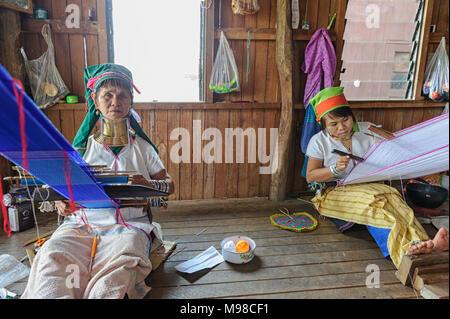 Padaung women weaving cloth, Inle Lake Myanmar - Stock Photo