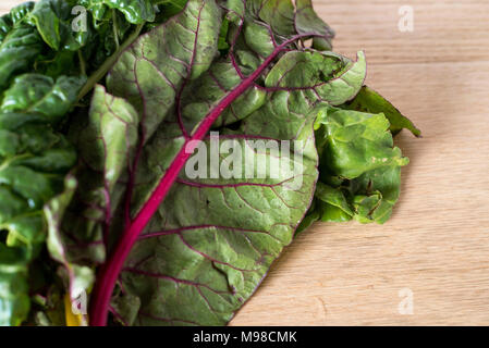 Red Rainbow Chard on a Light Wood Counter - Stock Photo