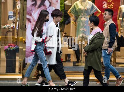 People walking along a main shopping street in Shanghai, China - Stock Photo