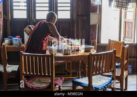 Mealtime at the Jumping Cat Monastery (Nga Hpe Chaung) Myanmar. Nga Hpe is a wooden monastery,  built on stilts on Inle Lake, just north of Ywama - Stock Photo
