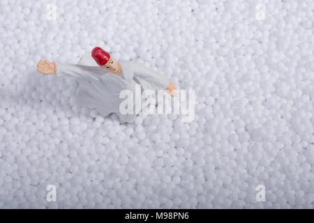 Sufi Whirling Dervish on little  white polystyrene foam balls - Stock Photo